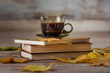 coffee cup books and leaves