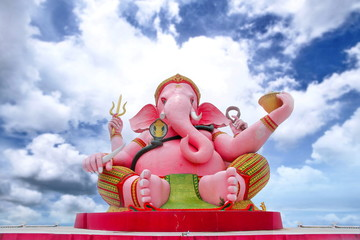 Graet pink Ganesha image is stituated outdoor and  cloudy sky of  Magha puja Buddha Park Memorial  in Garden Buddha Jayanti 2600 years.