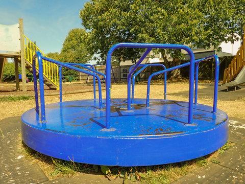 Blue playground merry go round