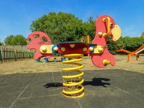 Red spring rider at childrens' playground