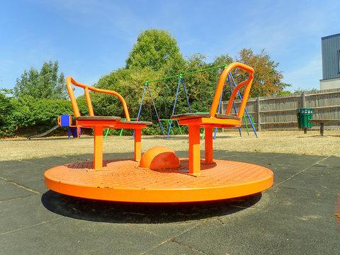 Orange playground merry go round