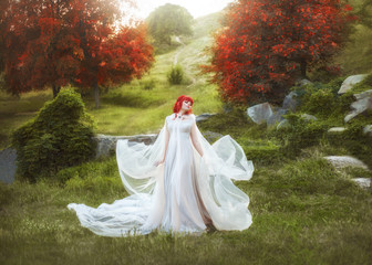 A young, red-haired elf waving a raincoat against the backdrop of autumn hills and a path that leaves at a distance. The wizard, like a bird, flaps her wings from the fabrics, in a white flying dress