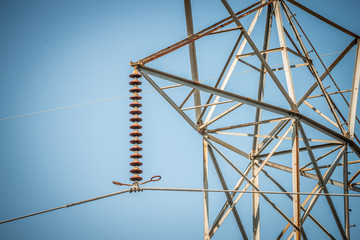 high voltage power lines on blue sky