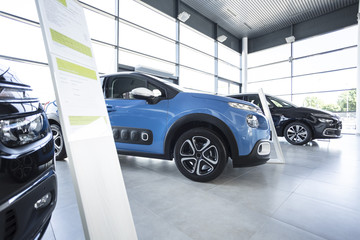 Exclusive vehicles in a car showroom with outlet