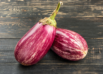 Two purple eggplants