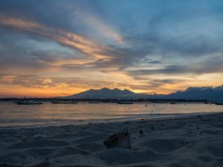 Sunrise on the island of Gili Trawangan, Indonesia. With golden sky and san on the beach. Indonesia, 2017