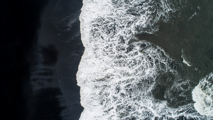 The black sand beach in Iceland. Sea aerial view and top view. Amazing nature, beautiful...