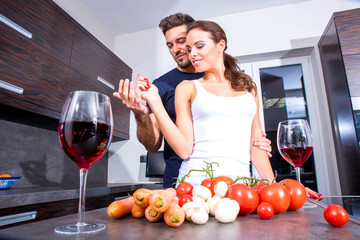 Beautiful young couple in the kitchen