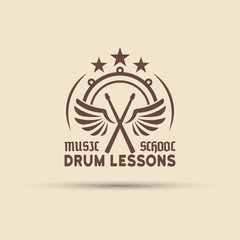 Drum school vector emblem with wings, drumsticks