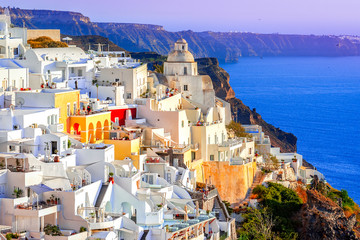 Foto auf Leinwand Flieder Fira, Santorini island, Greece: Traditional and famous white houses over the Caldera, Aegean sea.