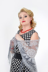 retro photo in 60's style, woman blonde in polka-dot dress with shawl
