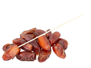 Dried dates with plastic stick, stem, isolated on white background