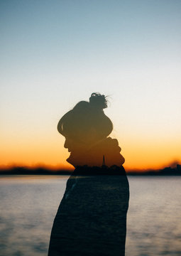 Woman in the sunrise