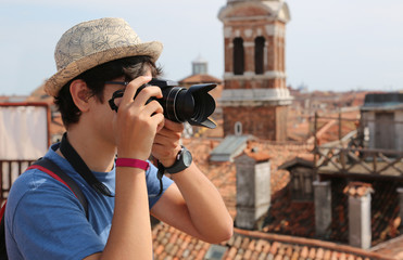 photographer takes many pictures in Venice in Italy