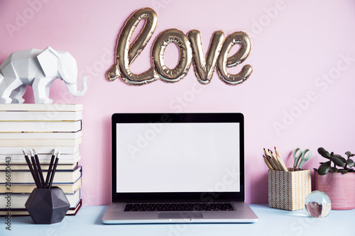 Stylish And Creative Desk With Laptop Mock Up Screen, Books, Office  Accessories, Elephant