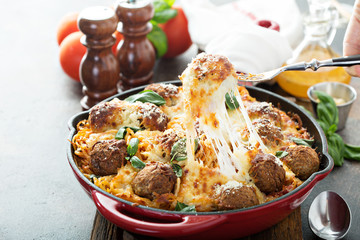 Baked meatballs with spaghetti and cheese