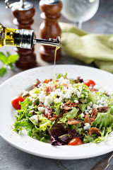 Green salad with blue cheese and bacon
