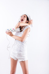 A beautiful young woman screaming with power cables in her hands