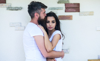 Tender hug. Couple in love romantic date cuddling outdoors light wall background. Man bearded and girl hugs or cuddling. So good to feel your hug. Couple in love enjoy each other romantic date