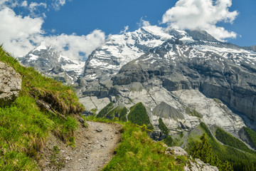 Wall Mural - Typical Alpine scenery with beautiful Doldenhorn peak