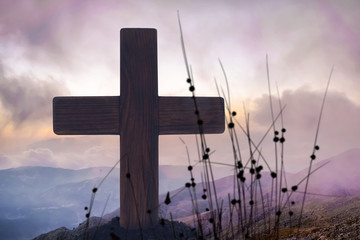 Wooden cross and landscape on background. Christian religion