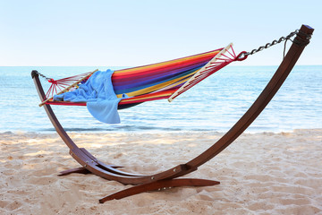 Colorful hammock with blanket at seaside. Summer vacation