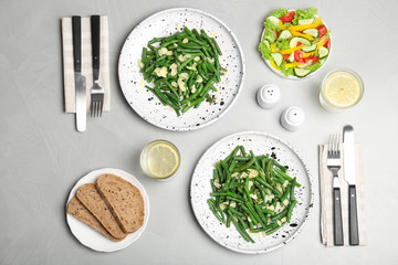 Tasty green beans with almonds served for dinner on table, top view