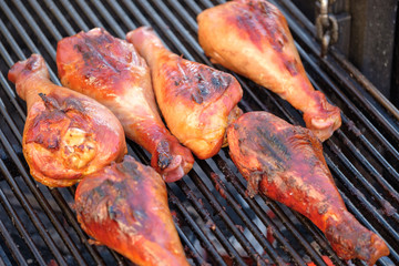 Barbecue legs of turkey on the grill.
