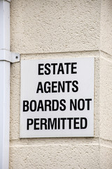 Estate agents boards not permitted warning sign UK