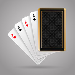 Four aces in five playing card with black back design on grey background. Winning poker hand. JPG include isolated path