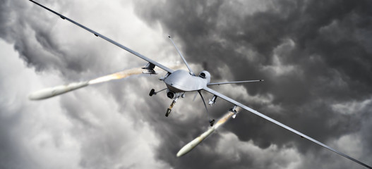 Drone strike .Front view of an unmanned aerial vehicle (UAV) military drone firing missile rockets at a target . 3d rendering