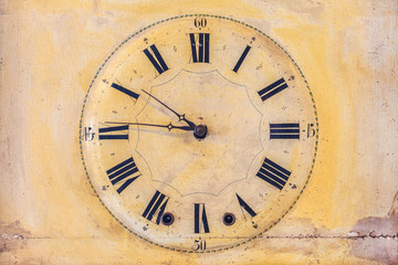 Ancient clock with roman numbers