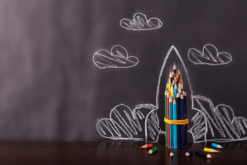 Rocket on black background. Back to school concept