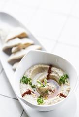 organic hummus dip and pita bread set snack in israel