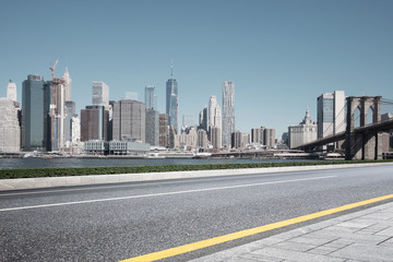 Fotomurales - asphalt street with modern city new york