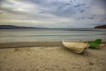 Fishing boats at the end of a day on sea beach background with copy space