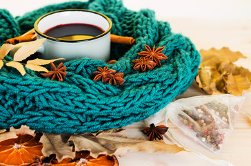 Autumn, fall leaves, hot steaming cup of glint wine