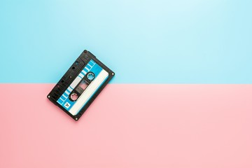 black tape cassette on blue and pink background. Wall mural