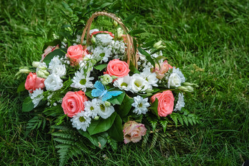 Beautiful bouquet of various flowers on grass.