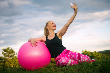 woman with Fitness ball making selfie