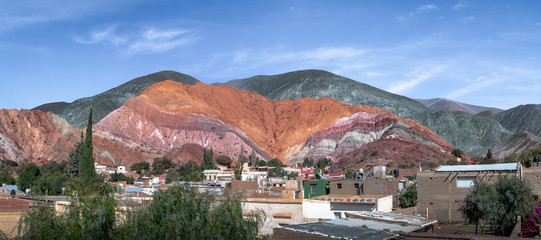Panoramic view of Purmamarca town with the Hill of Seven Colors (Cerro de los siete colores) on background  - Purmamarca, Jujuy, Argentina