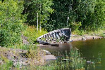 Abandoned broken boat on the river