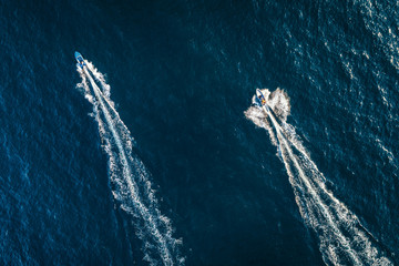 Speed boat on the sea, aerial top view