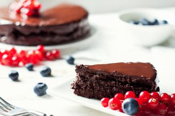 Gluten free chocolate cake with berries