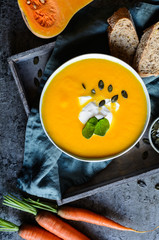 Pumpkin and carrot soup with sour cream