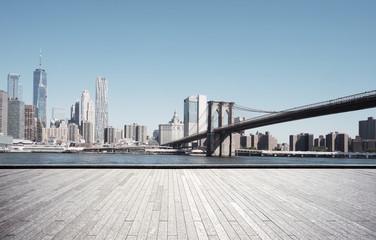 Spoed Fotobehang Brooklyn Bridge empty street with modern city new york as background