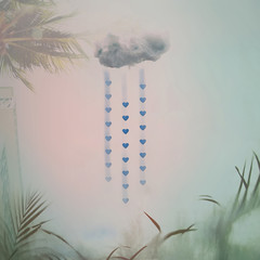 Cotton cloud and hearts on a blue background.