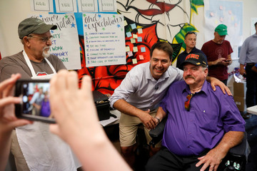 Democratic candidate Danny O'Connor poses for a photograph with Vietnam veteran Roger Tackett  ahead of Tuesday's special election, at his headquarters in Columbus, Ohio