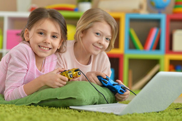 little girls playing computer game