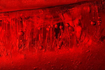 Air bubbles in red ice. Abstract background